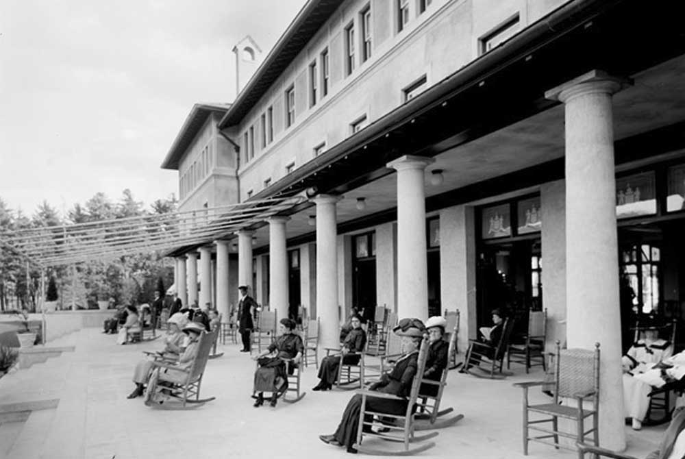 Guests Relaxing in Rocking Chairs at Fort William Henry